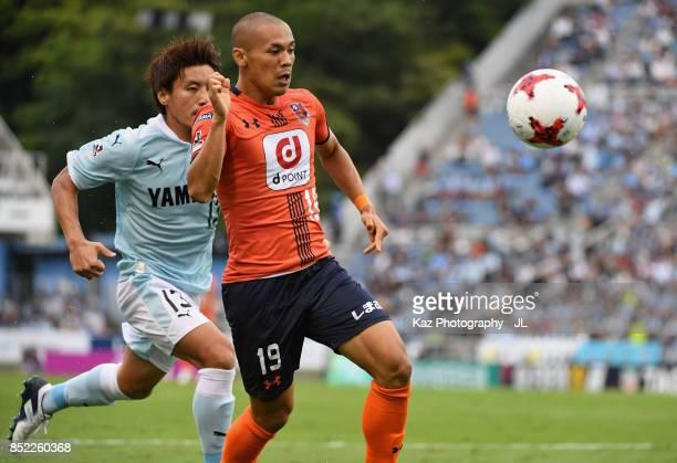 Ryo Okui of Omiya Ardija and Tomohiko Miyazaki of Jubilo Iwata compete for the ball during the J.League J1 match between Jubilo Iwata and Omiya...