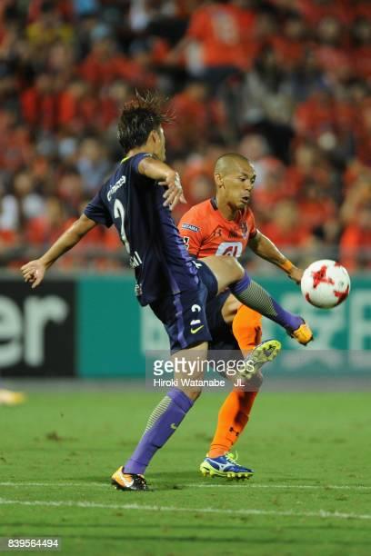Ryo Okui of Omiya Ardija and Yuki Nogami of Sanfrecce Hiroshima compete for the ball during the J.League J1 match between Omiya Ardija and Sanfrecce...