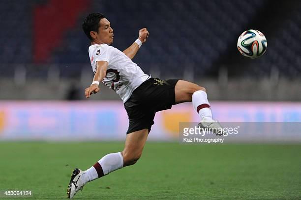 Ryo Okui of Vissel Kobe challenges the floating ball during the J. League match between Urawa Red Diamonds and Vissel Kobe at Saitama Stadium on...
