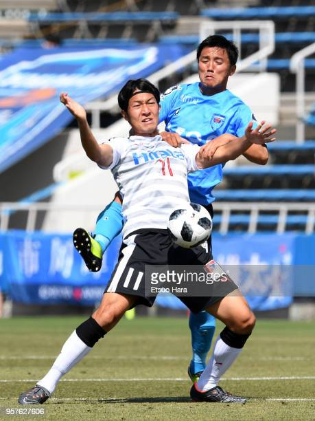 Ryo Tadokoro of Yokohama FC and Yusuke Minagawa of Roasso Kumamoto compete for the ball during the J.League J2 match between Yokohama FC and Roasso...