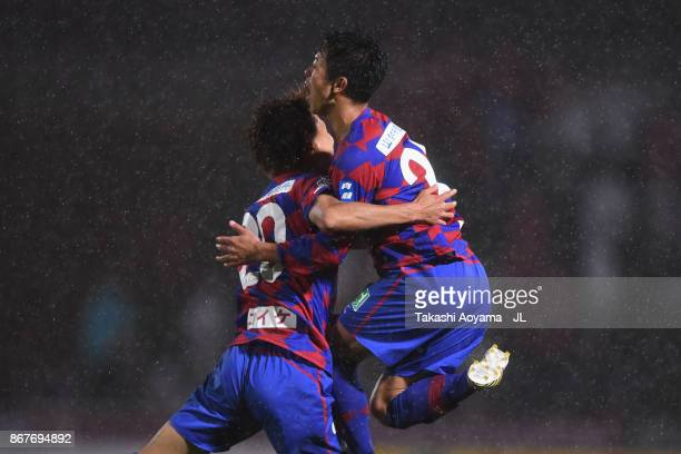 Ryo Takano of Ventforet Kofu celebrates scoring his side's second goal with his team mate Masato Kurogi during the JLeague J1 match between Ventforet...