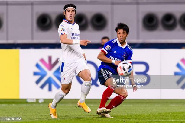 Ryo Takano of Yokohama Marinos plays against Kim Taehwan of Suwon Samsung during the AFC Champions League Round of 16 match between Yokohama...