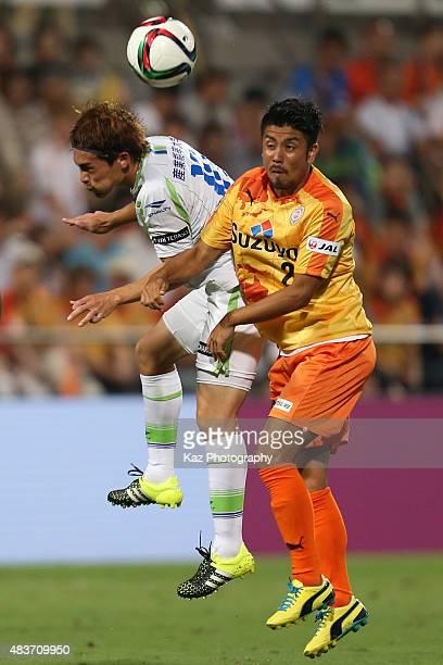 Ryo Takeuchi of Shimizu S-Pulse and Daisuke Kikuchi of Shonan Bellmare compete for the ball during the J.League match between Shimizu S-Pulse and...
