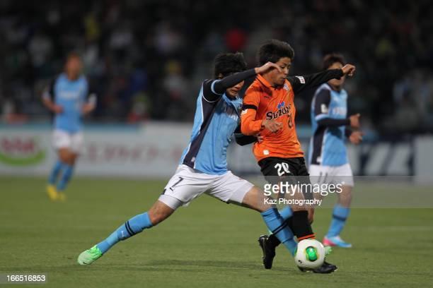 Ryo Takeuchi of Shimizu S-Pulse and Yuki Kobayashi of Jubilo Iwata compete for the ball during the J.League match between Shimizu S-Pulse and Jubilo...