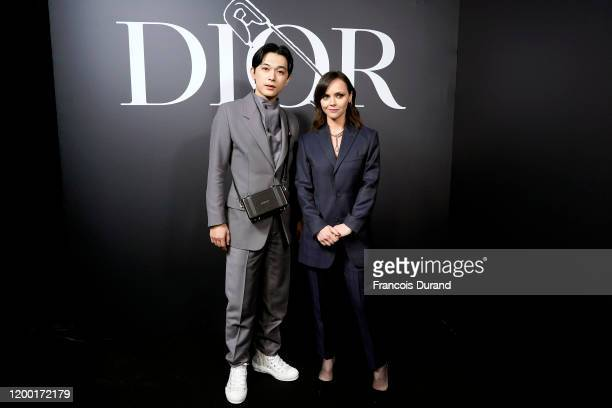 Ryo Yoshizawa and Christina Ricci attend the Dior Homme Menswear Fall/Winter 20202021 show as part of Paris Fashion Week on January 17 2020 in Paris...