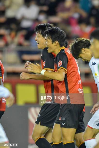 Ryogo YAMASAKI of Nagoya Grampus celebrates scoring his side's first goal with his team mates during the J.League Meiji Yasuda J1 match between...