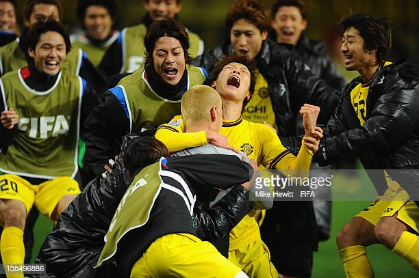 Ryohei Hayashi of Kashiwa Reysol is mobbed by team mates after scoring the deciding penalty during the FIFA Club World Cup Quarter Final match...