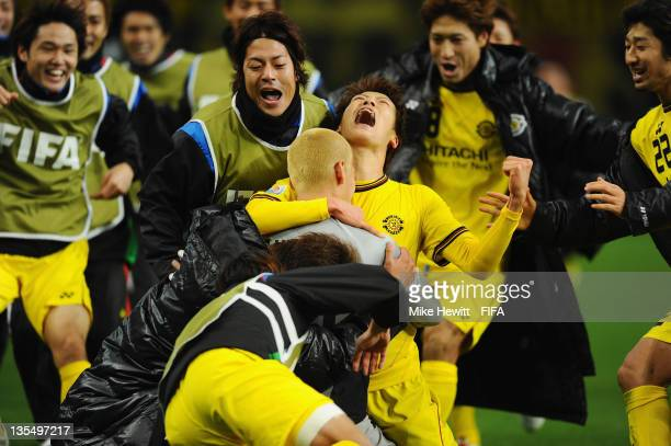 Ryohei Hayashi of Kashiwa Reysol is mobbed by teammates after scoring the deciding penalty during the FIFA Club World Cup Quarter Final match between...