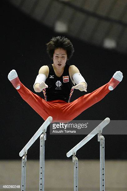 Ryohei Kato of Japan competes on the Parallel Bars during day two of the Artistic Gymnastics NHK Trophy at Yoyogi National Gymnasium on June 8 2014...