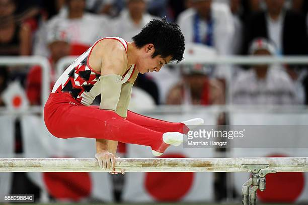 Ryohei Kato of Japan competes on the parallel bars during the Men's Individual AllAround final on Day 5 of the Rio 2016 Olympic Games at the Rio...