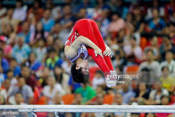 Ryohei Kato of Japan performs on the Parallel Bars during the Men's Parallel Bars Final on day six of the 45th Artistic Gymnastics World...
