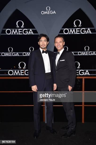 Ryohei Otani and Raynald Aeschlimann attend the OMEGA Aqua Terra at Palazzo Pisani Moretta on October 28 2017 in Venice Italy