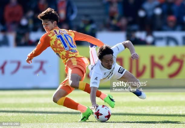Ryohei Shirasaki of Shimizu SPulse and Naoyuki Fujita of Vissel Kobe compete for the ball during the JLeague J1 match between Shimizu SPulse and...