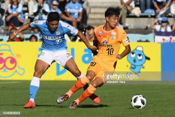 Ryohei Shirasaki of Shimizu SPulse and Yoshito Okubo of Jubilo Iwata compete for the ball during the JLeague J1 match between Shimizu SPulse and...