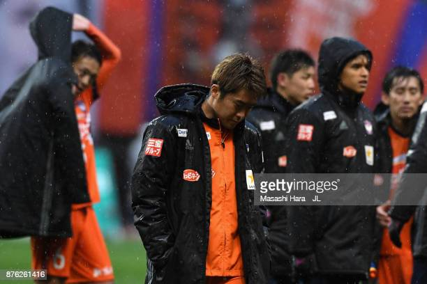 Ryohei Yamazaki and Albirex Niigata players show dejection after their relegation despite their 10 victory in the JLeague J1 match between Albirex...