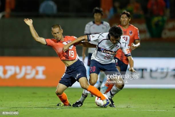 Ryoichi Maeda of FC Tokyo and Ryo Okui of Omiya Ardija compete for the ball during the J.League J1 match between Omiya Ardija and FC Tokyo at NACK 5...