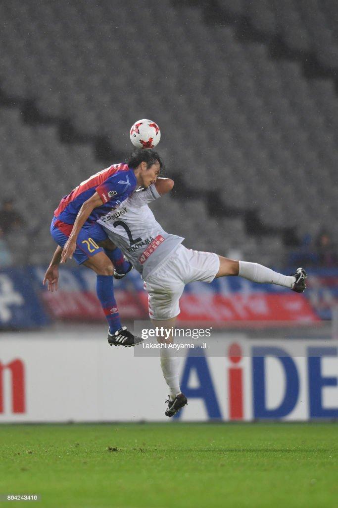 Ryoichi Maeda of FC Tokyo and Tomonobu Yokoyama of Consadole Sapporo compete for the ball during the J.League J1 match between FC Tokyo and Consadole Sapporo at Ajinomoto Stadium on October 21, 2017 in Chofu, Tokyo, Japan.