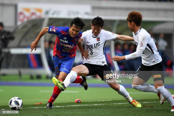 Ryoichi Maeda of FC Tokyo and Tomoya Ugajin of Urawa Red Diamonds compete for the ball during the JLeague J1 match between FC Tokyo and Urawa Red...