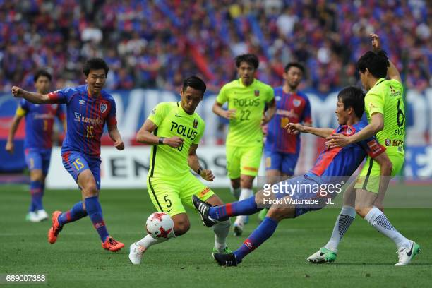Ryoichi Maeda of FC Tokyo competes for the ball against Tomoaki Makino and Wataru Endo of Urawa Red Diamonds during the J.League J1 match between FC...