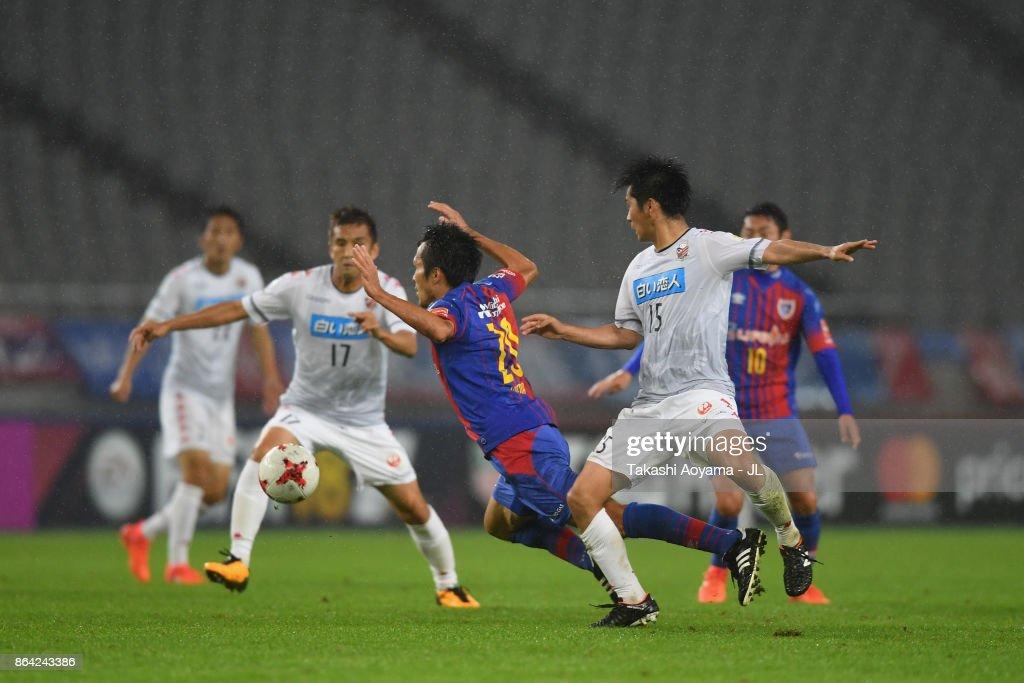 Ryoichi Maeda of FC Tokyo is tackled by Naoya Kikuchi of Consadole Sapporo during the J.League J1 match between FC Tokyo and Consadole Sapporo at Ajinomoto Stadium on October 21, 2017 in Chofu, Tokyo, Japan.