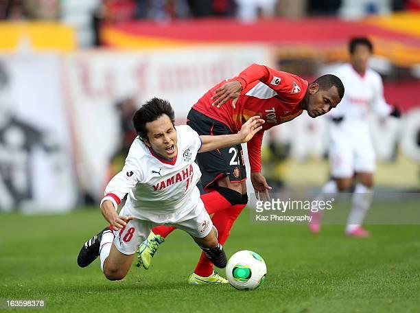 Ryoichi Maeda of Jubilo Iwata is tackled by Daniel Silva Dos Santos of Nagoya Grampus during the J.League match between Nagoya Grampus and Jubilo...