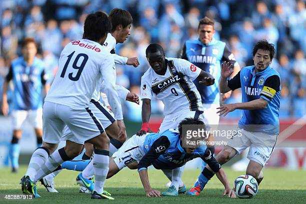 Ryoichi Maeda of Jubilo Iwata is tacled by Thespa Kusatsu Gunma players during the JLeague second division match between Jubilo Iwata and Thespa...