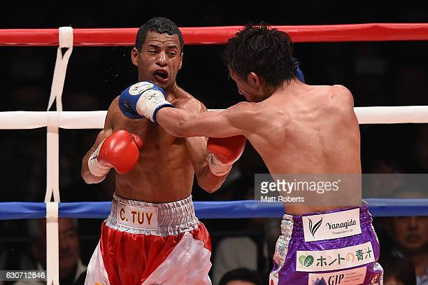 Ryoichi Taguchi punches Carlos Canizales during the WBA World Light Flyweight Title bout between Ryoichi Taguchi of Japan and Carlos Canizales of...