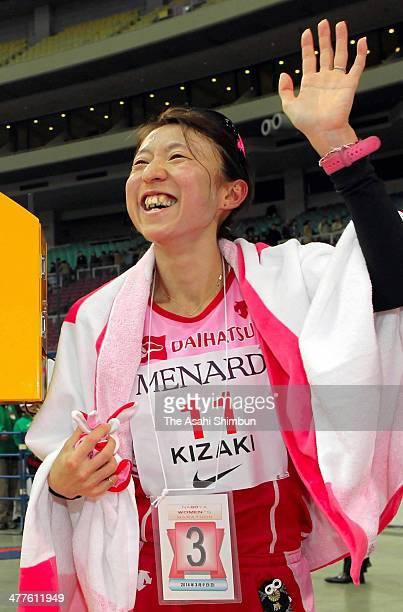 Ryoko Kizaki of Japan celebrates her third finish during the Nagoya Women's Marathon 2014 at Nagoya Dome on March 9 2014 in Nagoya Aichi Japan