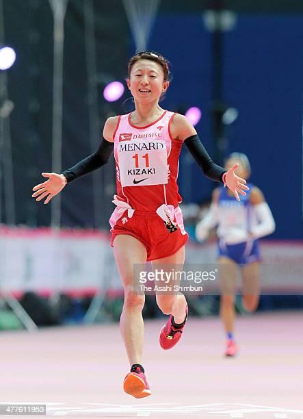 Ryoko Kizaki of Japan crosses the finishing line as third during the Nagoya Women's Marathon 2014 at Nagoya Dome on March 9 2014 in Nagoya Aichi Japan