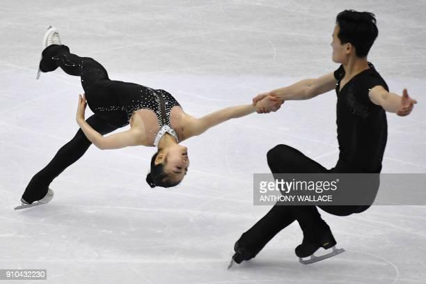 TOPSHOT Ryom TaeOk and Kim JuSik of North Korea perform during the pairs free skating program at the ISU Four Continents figure skating championships...