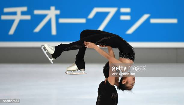 Ryom TaeOk and Kim JuSik of North Korea perform during their pairs free skating program of the 49th Nebelhorn trophy figure skating competition in...