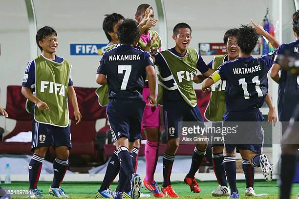Ryoma Watanabe of Japan celebrates his team's third goal with team mates during the FIFA U-17 World Cup UAE 2013 Group D match between Japan and...