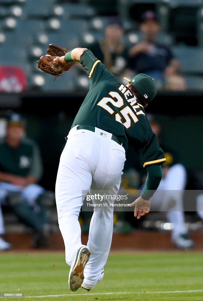 Ryon Healy #25 of the Oakland Athletics catches a pop-up off the bat of Norichika Aoki #3 of the Houston Astros in the top of the fifth inning at Oakland Alameda Coliseum on June 21, 2017 in Oakland, California.