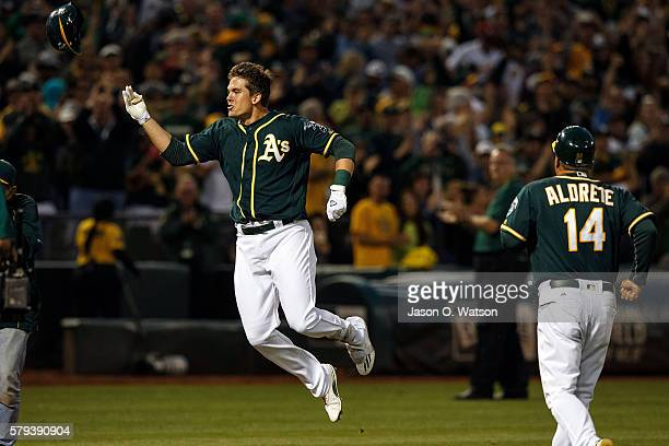 Ryon Healy of the Oakland Athletics celebrates after hitting a walk off home run against the Tampa Bay Rays during the ninth inning at the Oakland...