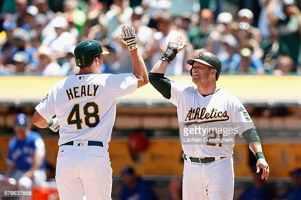 Ryon Healy of the Oakland Athletics celebrates with Stephen Vogt of the Oakland Athletics after hitting a home run in the second inning against the...