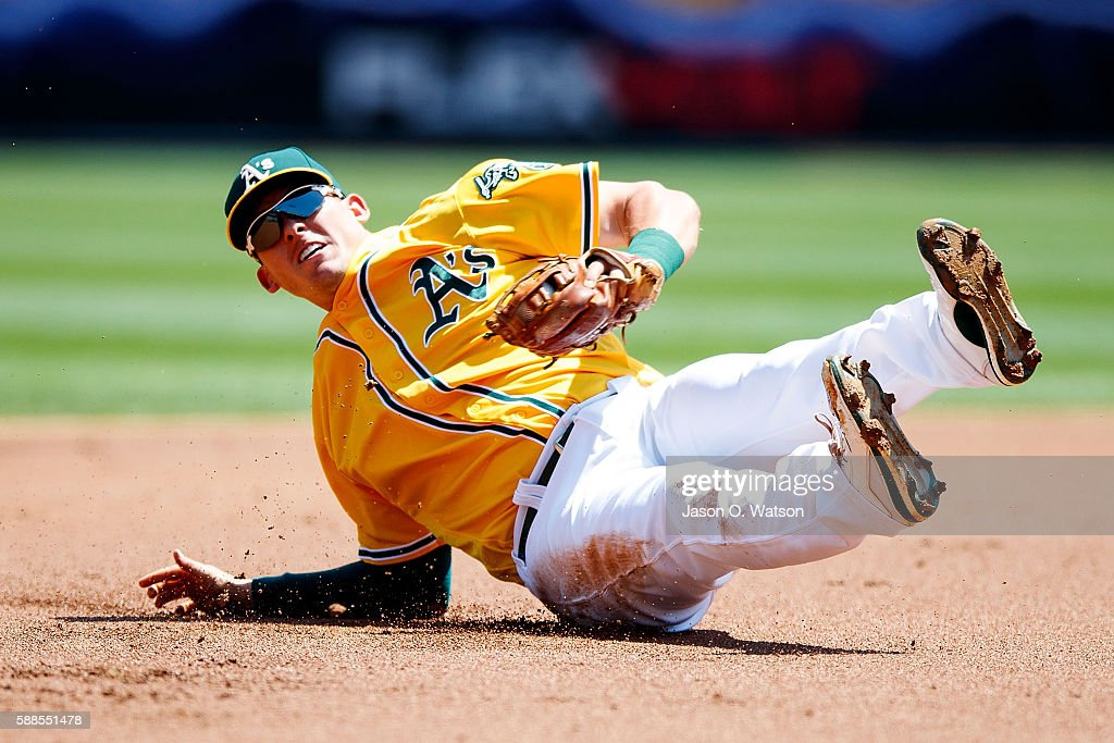 Ryon Healy #48 of the Oakland Athletics dives for and fields a ground ball hit off the bat of Manny Machado (not pictured) of the Baltimore Orioles during the first inning at the Oakland Coliseum on August 11, 2016 in Oakland, California.
