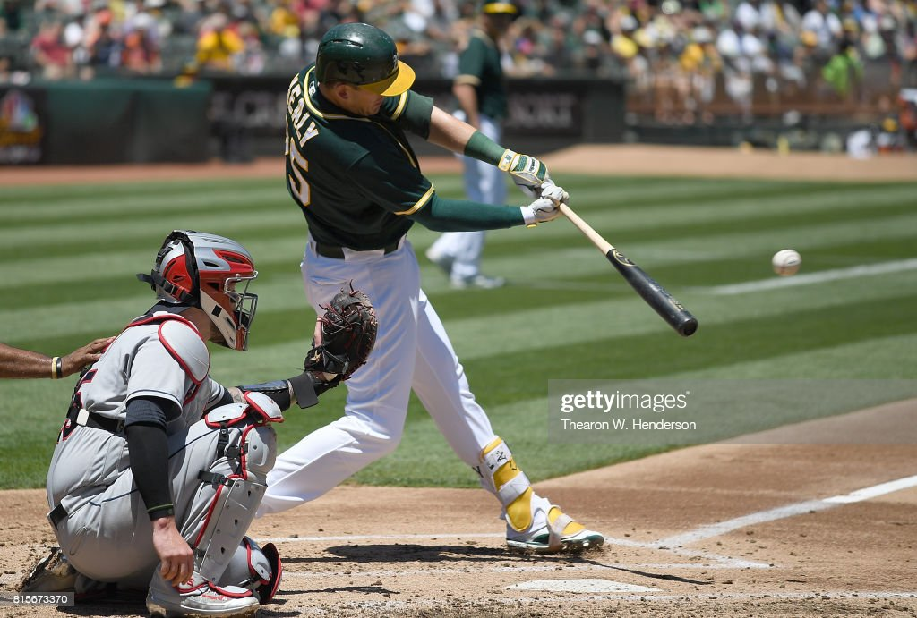 Ryon Healy #25 of the Oakland Athletics hits a bases loaded two-run rbi single against the Cleveland Indians in the bottom of the first inning at Oakland Alameda Coliseum on July 16, 2017 in Oakland, California.