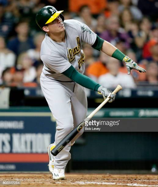 Ryon Healy of the Oakland Athletics hits a grand slam off James Hoyt of the Houston Astros in the sixth inning at Minute Maid Park on June 27, 2017...