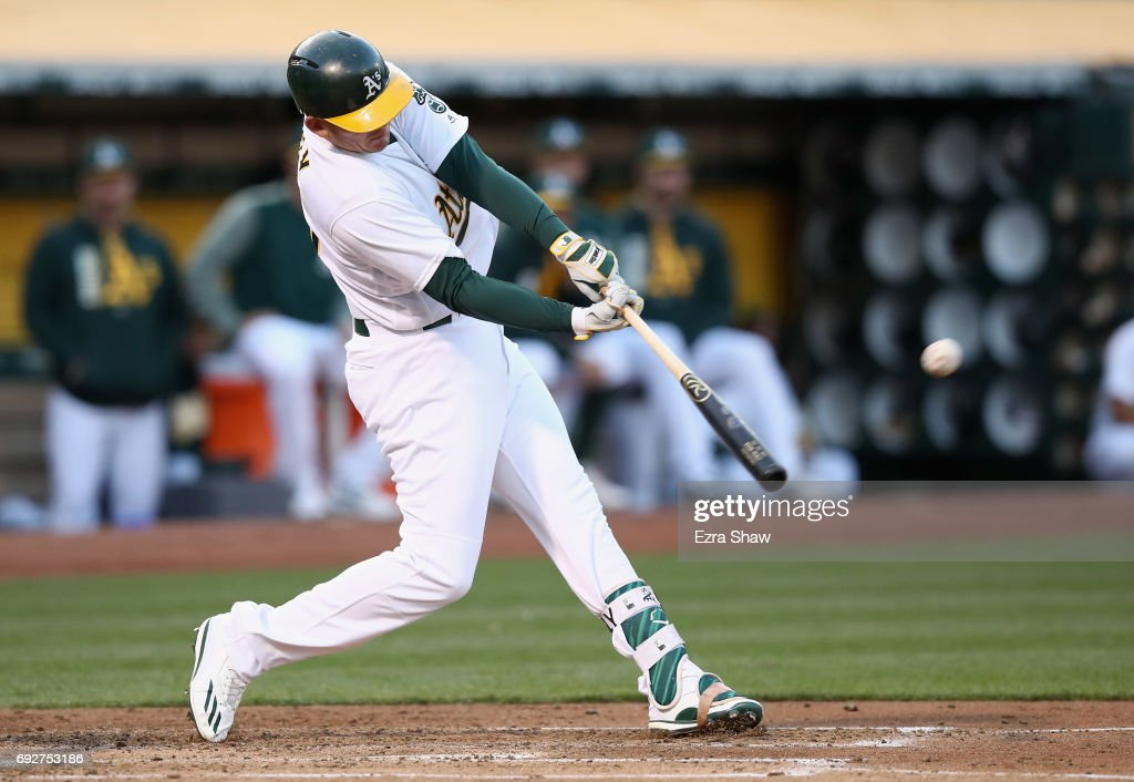 Ryon Healy #25 of the Oakland Athletics hits a three-run home run in the second inning against the Toronto Blue Jays at Oakland Alameda Coliseum on June 5, 2017 in Oakland, California.