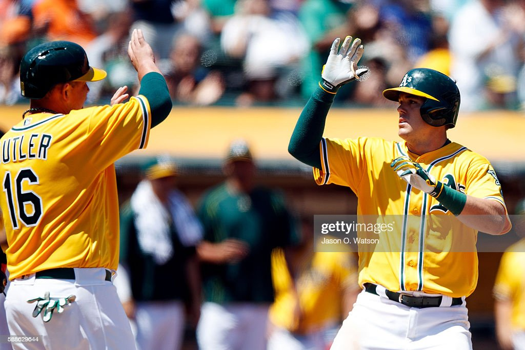 Ryon Healy #48 of the Oakland Athletics is congratulated by Billy Butler #16 after hitting a two run home run against the Baltimore Orioles during the fifth inning at the Oakland Coliseum on August 11, 2016 in Oakland, California. The Baltimore Orioles defeated the Oakland Athletics 9-6.