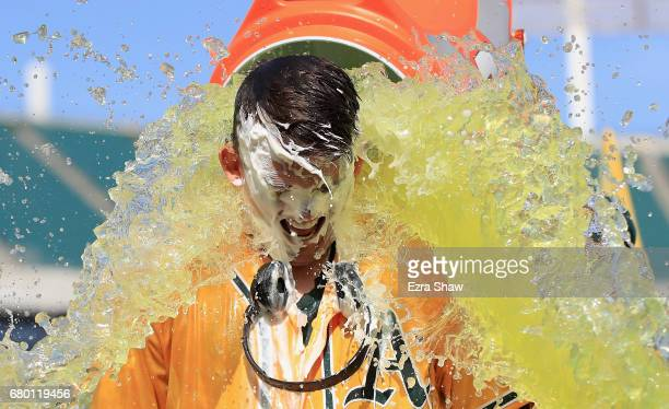 Ryon Healy of the Oakland Athletics is covered in Gatorade after he hit a walk-off home run in the ninth inning against the Detroit Tigers at Oakland...
