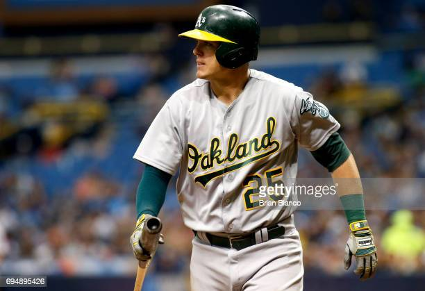 Ryon Healy of the Oakland Athletics makes his way to the dugout after striking out swinging to pitcher Chris Archer of the Tampa Bay Rays during the...