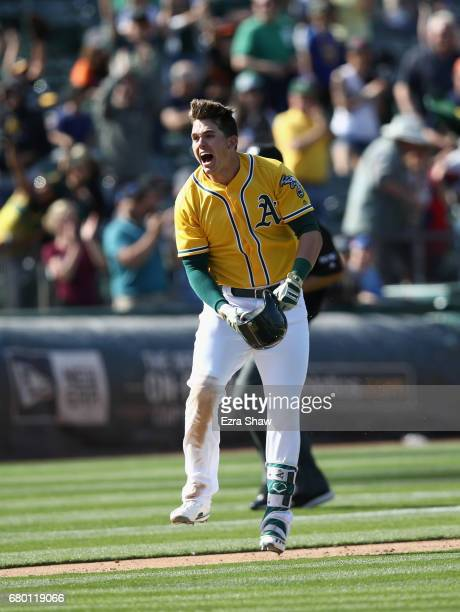 Ryon Healy of the Oakland Athletics reacts as he runs to home plate after he hit a walkoff home run in the ninth inning against the Detroit Tigers at...