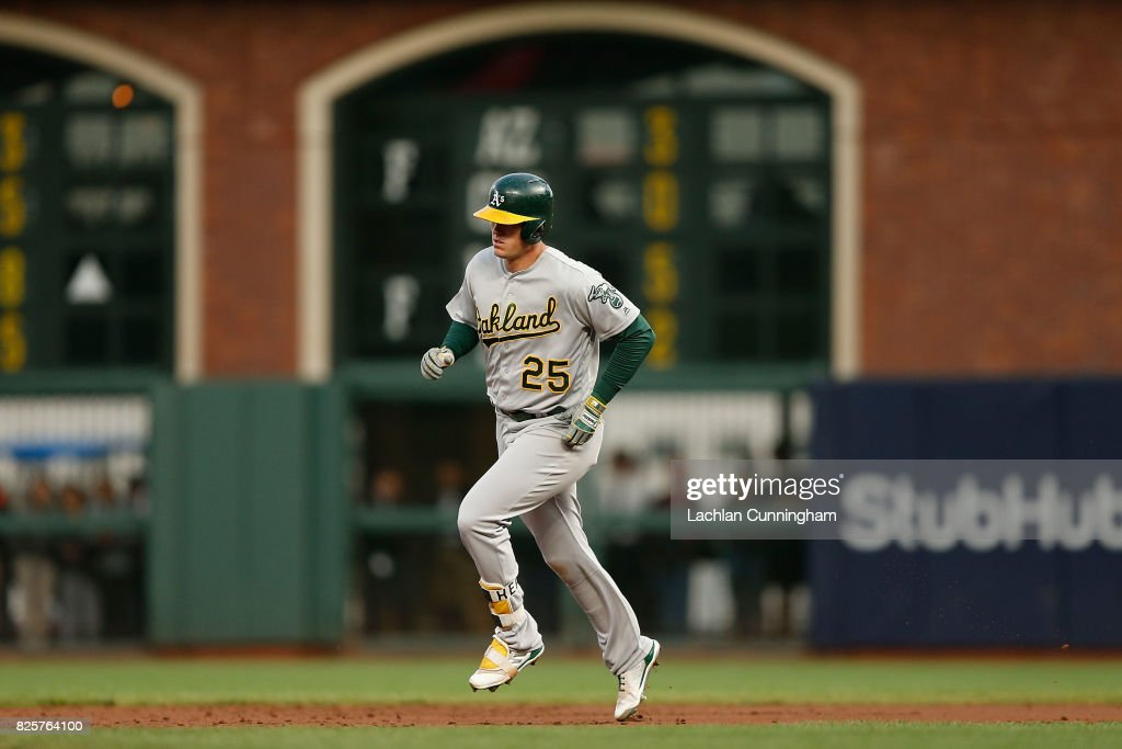 Ryon Healy #25 of the Oakland Athletics rounds the bases after hitting a two-run home run in the third inning against the San Francisco Giants in an interleague game at AT&T Park on August 2, 2017 in San Francisco, California.