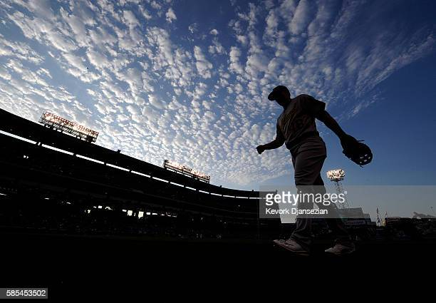 Ryon Healy of the Oakland Athletics walks back to the dugout after warming up prior to the start of the baseball game against the Los Angeles Angels...