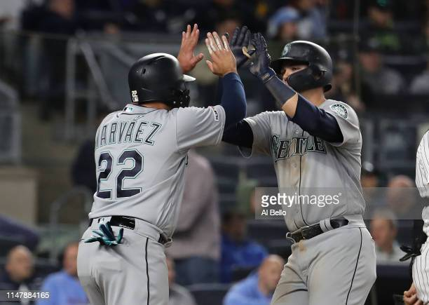 Ryon Healy of the Seattle Mariners celebrates with Omar Narvaez after hitting an eighth inning home run against Jake Barrett of the New York Yankees...