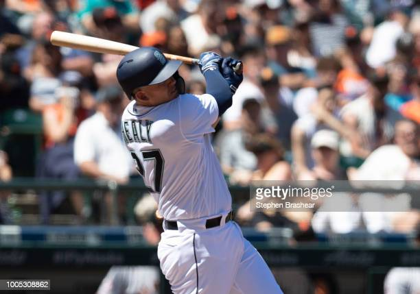 Ryon Healy of the Seattle Mariners hits a solo home run off of starting pitcher Derek Holland of the San Francisco Giants during the second inning of...