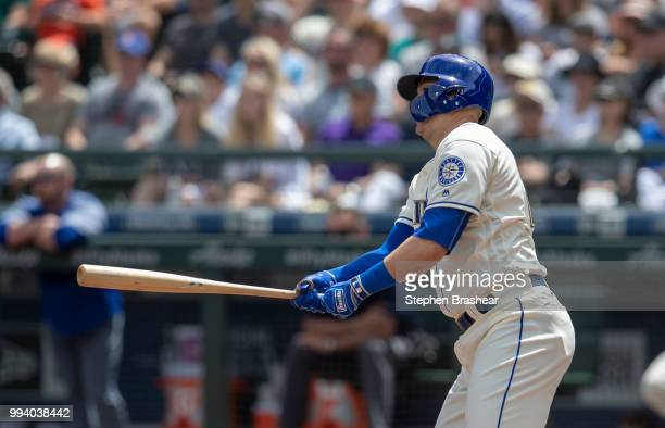 Ryon Healy of the Seattle Mariners hits a two-run double off of starting pitcher Antonio Senzatela of the Colorado Rockies that also scored Mitch...