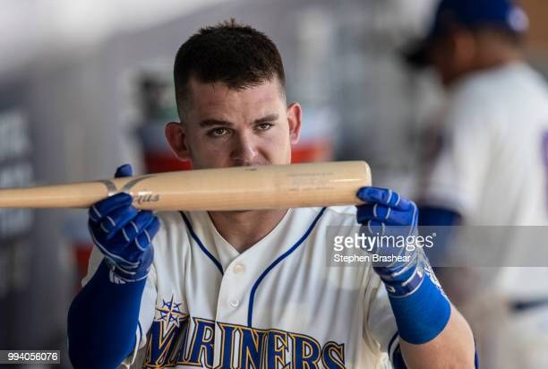 Ryon Healy of the Seattle Mariners holds up teammate Mitch Haniger's bat after Healy hit a three-run home run off of starting pitcher Antonio...
