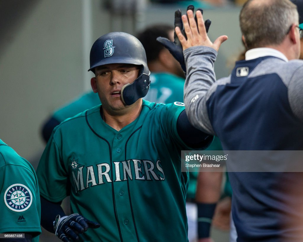 Ryon Healy #27 of the Seattle Mariners is congratulated after scoring a run on a fielder's choice hit by David Freitas #36 of the Seattle Mariners off of relief pitcher Austin Pruitt #50 of the Tampa Bay Rays during the fourth inning of a game at Safeco Field on June 1, 2018 in Seattle, Washington.